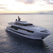 Cruising motor yacht / with enclosed flybridge / GRP / displacement hull