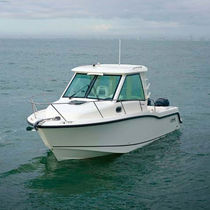 Outboard cabin cruiser / twin-engine / with enclosed cockpit / sport-fishing