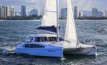 Sailing catamaran / cruising / open transom / 3-cabin