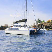 Sailing catamaran / cruising-racing / open transom / 2-cabin