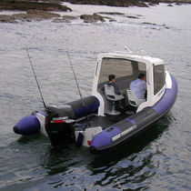 Outboard utility boat / inflatable boat / semi-rigid / with enclosed cockpit