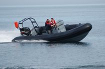 Outboard utility boat / inflatable boat / semi-rigid / with jockey console