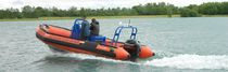 Outboard multi-purpose work boat / inflatable boat / center console