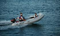 Outboard inflatable boat / semi-rigid / center console / 7-person max.