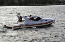 Inboard inflatable boat / semi-rigid / with enclosed cockpit / with cabin