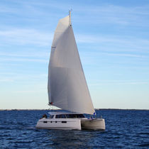 Sailing catamaran / ocean cruising / open transom / with 3 or 4 cabins