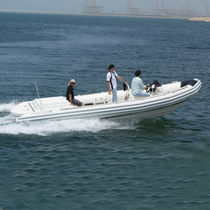 Inboard multi-purpose work boat / rigid hull inflatable boat