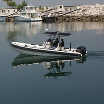 Outboard harbor service boat / rigid hull inflatable boat
