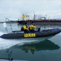Outboard work boat / rigid hull inflatable boat