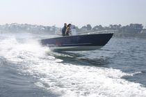 Outboard utility boat