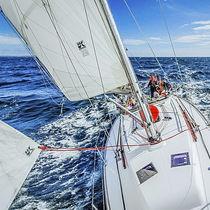 Mainsail / for cruising sailboats / radial cut / Dacron®