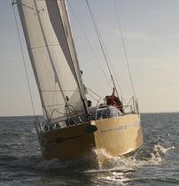 Ocean cruising sailboat / open transom / 2-cabin / bilge keel