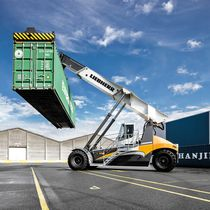 Reach-stacker with top-lift spreader / for containers