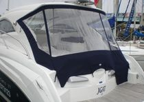 Power boat cockpit enclosure