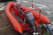 Outboard utility boat / rigid hull inflatable boat