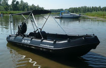 Outboard small boat / side console / rotation-molded / HDPE