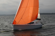 Cruising sailboat / open transom / lifting keel / with bowsprit