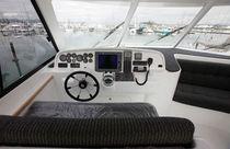 Catamaran express cruiser / inboard / with enclosed flybridge / aluminum