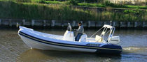 equipped rigid inflatable boat (outboard, center console, sundeck, roll-bar) 62 Asso-Prestige