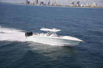 motor-boat : outboard center console boat (four engines, cabin, T-Top) 39 CUDDY Midnight Express