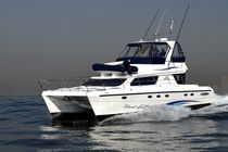 power catamaran : sport-fishing flybridge express-cruiser POWERCAT 450 African Cats
