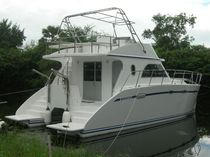 power catamaran : express-cruiser (semi-custom) ROBERTS 36 Coastal Boats