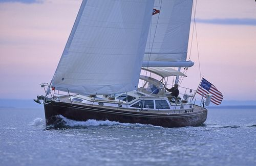 ocean cruising sailing yacht / center cockpit / fiberglass / 3-cabin