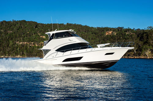 cruising motor yacht / with enclosed flybridge / planing hull / 3-cabin