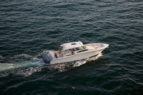 outboard express cruiser / four-engine / with enclosed cockpit / center console