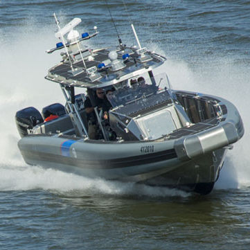 patrol boat / outboard / aluminum / rigid hull inflatable boat