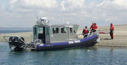 patrol boat / outboard / rigid hull inflatable boat / aluminum