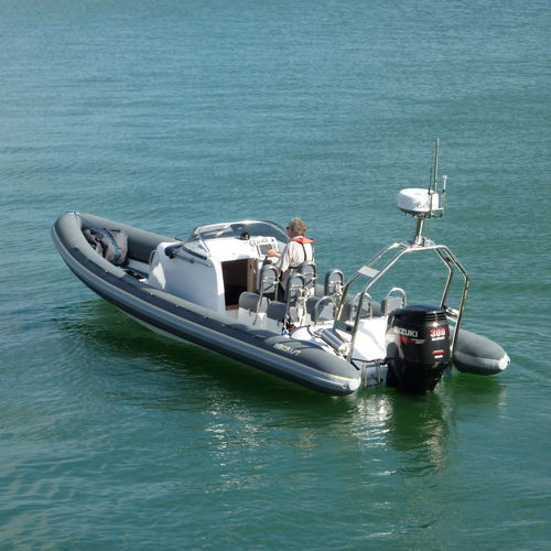 outboard inflatable boat / rigid / with jockey console / sport