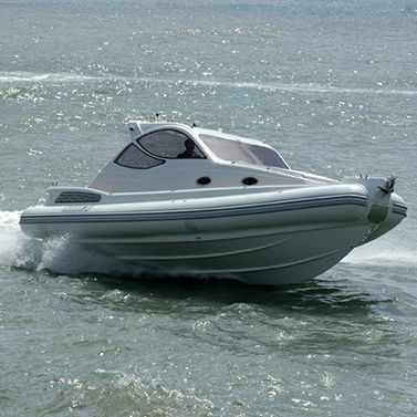 inboard inflatable boat / twin-engine / rigid / with enclosed cockpit
