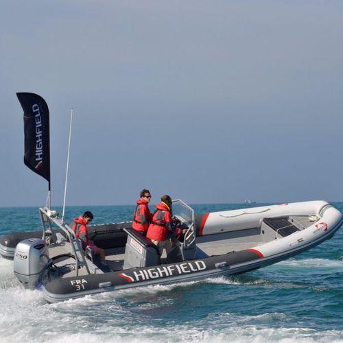 patrol boat / outboard / aluminum / rigid hull inflatable boat