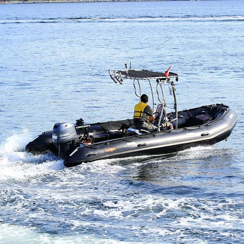 outboard inflatable boat / rigid / center console / with jockey console
