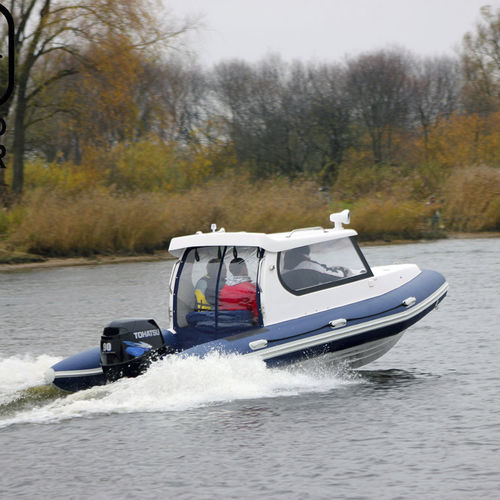 outboard inflatable boat / rigid / with enclosed cockpit / 8-person max.