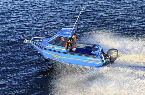 outboard walkaround / with enclosed cockpit / sport-fishing / 6-person max.