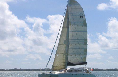 sailing catamaran / fast cruising / charter / open transom