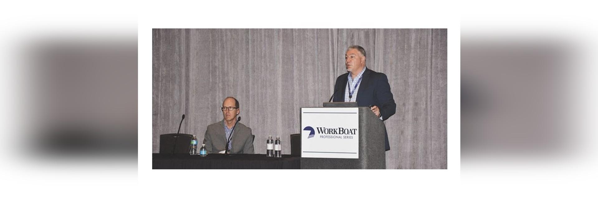Chris DeWitt (left) and Steve Burke discuss cybersecurity at the 2016 International WorkBoat Show. Doug Stewart photo.
