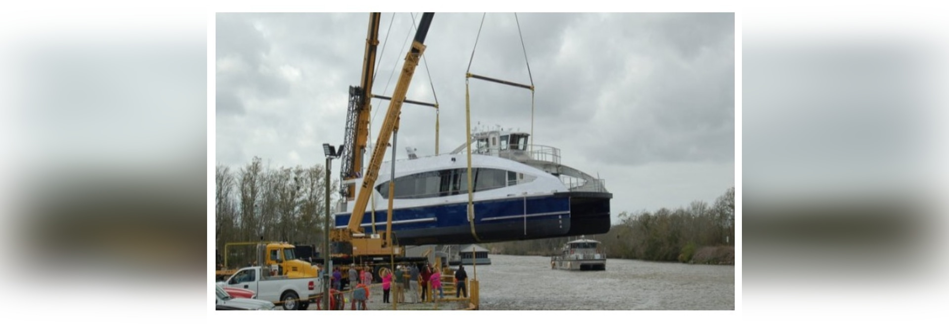First new aluminum ferry for Citywide Ferry from Metal Shark travels to the water by air, assisted by two cranes.