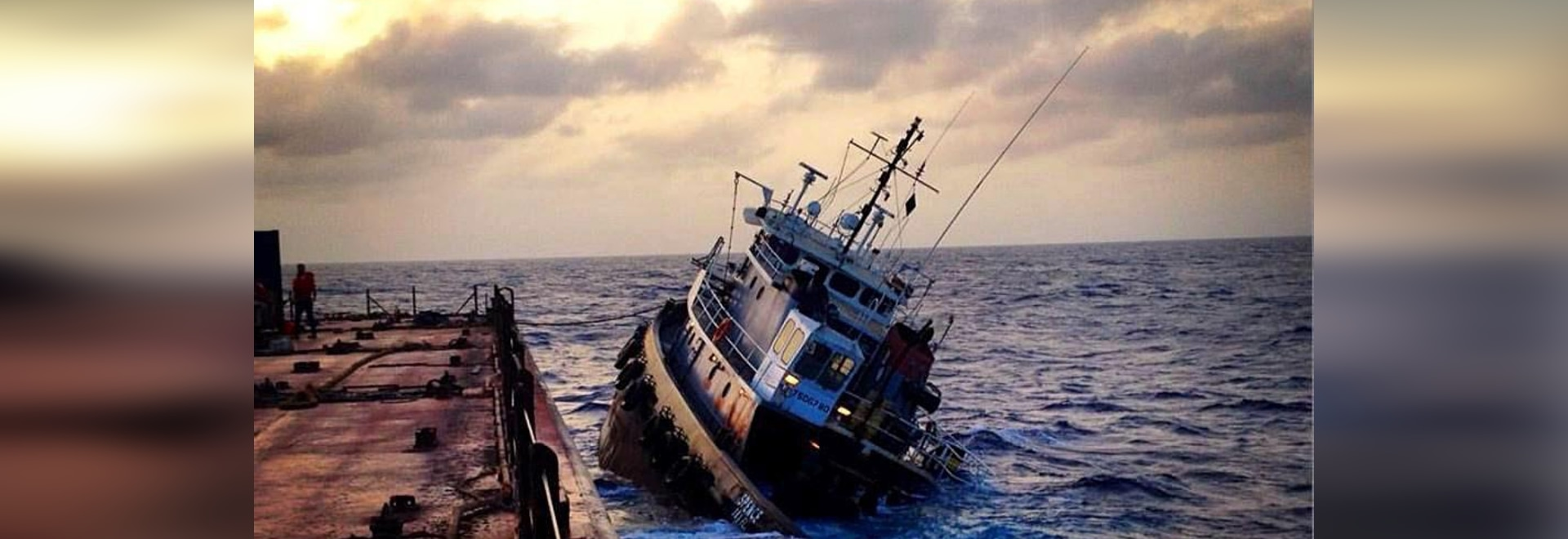 Spence shortly before sinking, after crewmembers had abandoned ship to barge Guantanamo Bay Express. (Photo by Spence crewmember provided by Coast Guard)