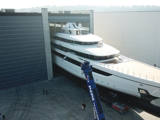 The yard has released new images showing the yacht emerging from the construction shed ahead of her launch C