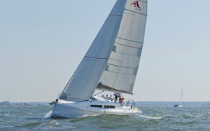 cruising sailboat / open transom / deck saloon / 2-cabin