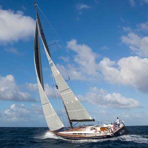 ocean cruising sailing yacht / open transom / 3-cabin / twin rudders
