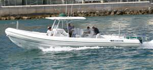 outboard inflatable boat / triple-engine / rigid / center console