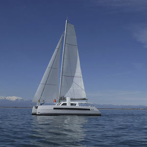 catamaran sailing yacht / ocean cruising / open transom / with 3 or 4 cabins