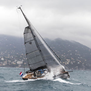 mainsail / for cruising sailing yachts / tri-radial cut / carbon