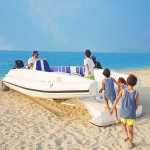 outboard inflatable boat / twin-engine / RIB / side console