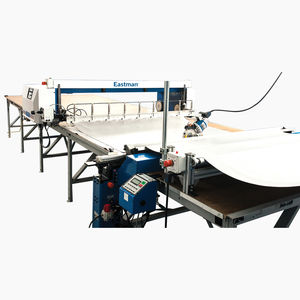 spreading machine with cutting system