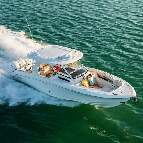 outboard express cruiser / triple-engine / open / dual-console